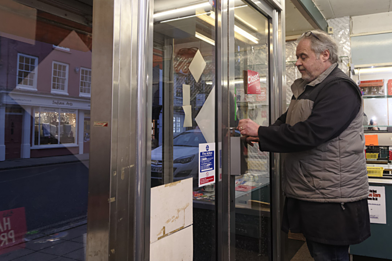Gary Castle locks up the shop for the last time