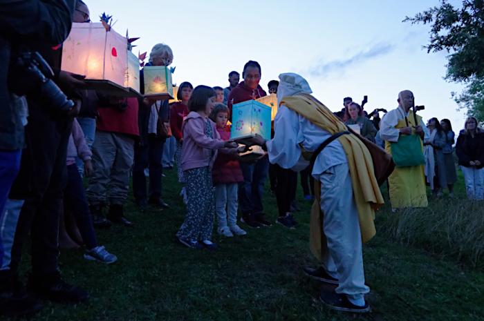 Giving peace lanterns to a nun