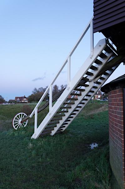 Windmill tail pole